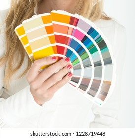 Unknown woman displaying a color swatch sampler