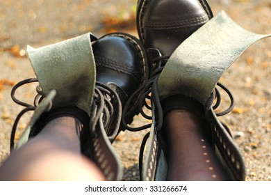 unlaced black leather boots