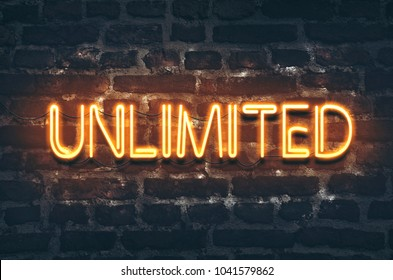 Unlimited neon sign on dark brick wall background