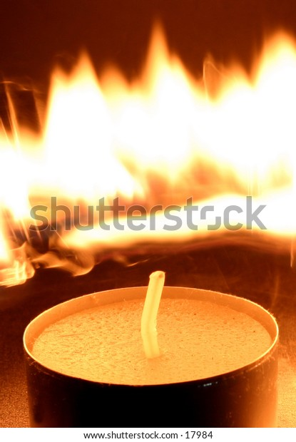 """An unlit candle with flames behind.  Could be used to display the theme of waiting for your moment.  """"My Day Will Come"""""""