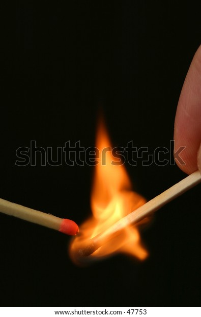 An unlit match being ignited by a flaming match