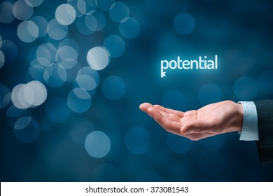 Unlock potential - motivational concept. Businessman with symbol of the key connected with text potential on hand. Bokeh in background.
