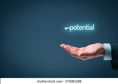 Unlock potential - motivational concept. Businessman with symbol of the key connected with text potential on hand.