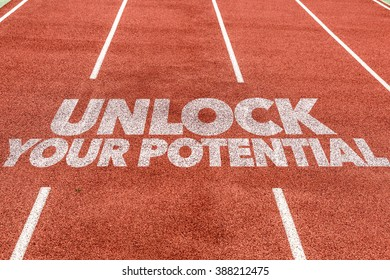 Unlock Your Potential written on running track