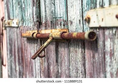 unlocked old door with latch
