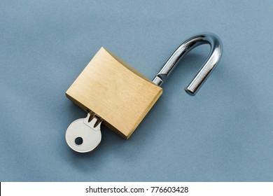 Unlocked Padlock on a blue background.