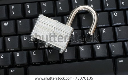 Unlocked padlock on keyboard representing an information security breach