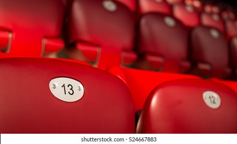 Unlucky Number Thirteen On Empty Red Chair