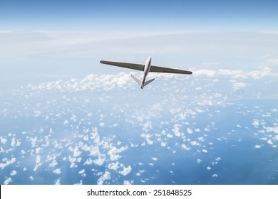 Unmanned aerial vehicle in the cloudy sky