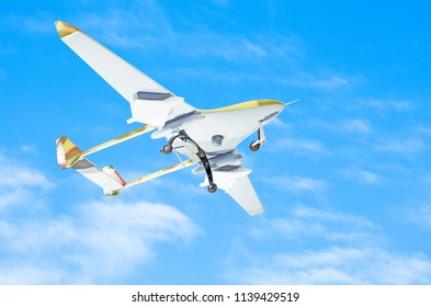 Unmanned aerial vessel is gaining altitude to track a mission against a blue sky