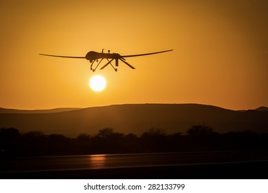 unmanned air vehicle remote piloted aircraft drone performing a low pass in sunset landscape panorama