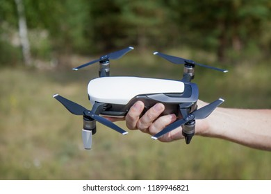 Unmanned aircraft with four rotors in the hand is ready for launch