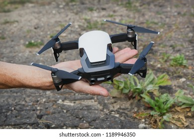 Unmanned aircraft with four rotors in the person's hand is ready for launch