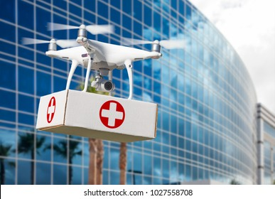 Unmanned Aircraft System (UAS) Quadcopter Drone Carrying First Aid Package Near Corporate Building.