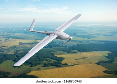 Unmanned military drone on patrol air territory at low altitude