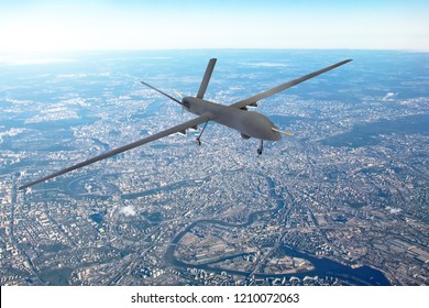 Unmanned military drone patrols the territory, flying over the disrtict of city
