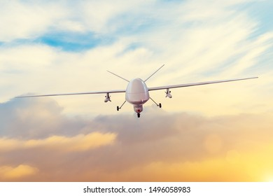 Unmanned military drone patrols the territory at sunset. The view is straight ahead