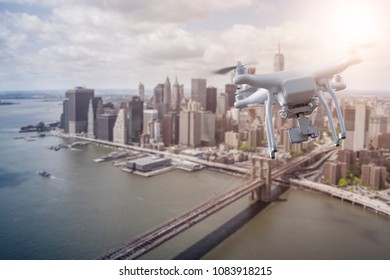 unmanned Multicopter drone flying over lower Manhatten, New York City