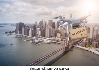 unmanned Multicopter drone flying with package over lower Manhatten, New York City