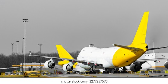 Unmarked Cargo planes sitting with engine on waiting to taking off  at a international airport
