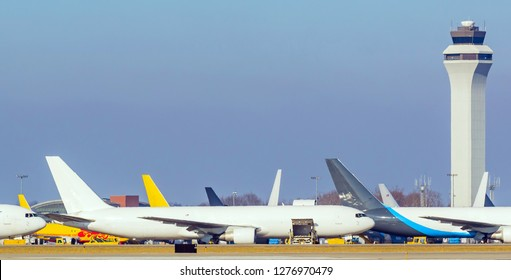 Unmarked Cargo planes  sitting waiting and loading at a an international airport