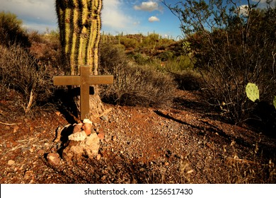 Unmarked grave besides a Saguaro cactus in Massacre grounds trail, pheonix.