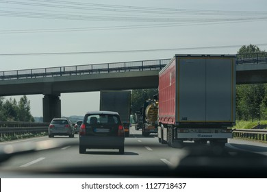UNNA, GERMANY - AUGUST 2, 2017: Traffic on the A2 motorway and Scholven coal power station, Germany, North Rhine-Westphalia.