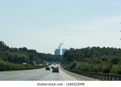 UNNA, GERMANY - AUGUST 23, 2017: Traffic on the A2 motorway and Scholven coal power station, Germany, North Rhine-Westphalia.