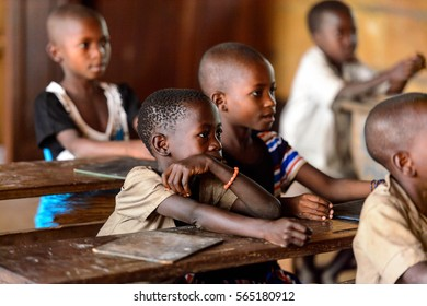 UNNAMED ROAD, TOGO - JAN 12, 2017: Unidentified Togolese little girl on the lesson in a local primary school. All subjects are in French language in Togo