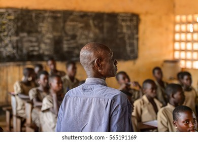 UNNAMED ROAD, TOGO - JAN 12, 2017: Unidentified Togolese teacher on the lesson in a local primary school. All subjects are in French language in Togo
