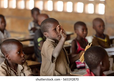 UNNAMED ROAD, TOGO - JAN 12, 2017: Unidentified Togolese little boy on the lesson in a local primary school. All subjects are in French language in Togo