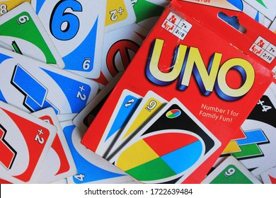 UNO board game pack in Moscow on May 2020. UNO colorful cards and deck on the table, family fun board game set for the age 6+ close up top view