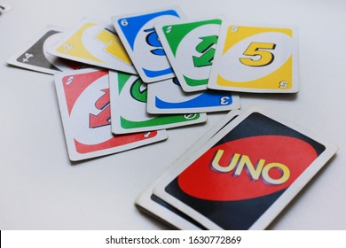 UNO board game playing cards in Moscow on January 2020. Uno game process with multicolored cards view on empty white table