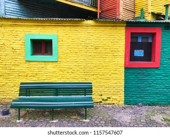 Unoccupied bank in the Caminito contrasting with wall and colored windows, city of Buenos Aires, Argentina