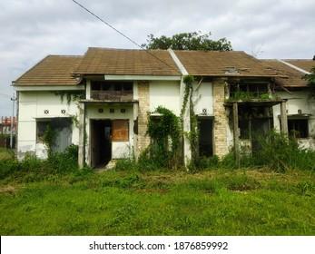unoccupied broken House with vines