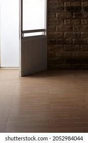 Unoccupied room with brick and floor with door