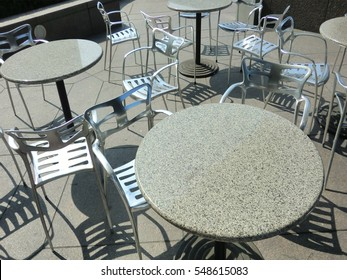 Unorganized patio furniture in outdoor cafe