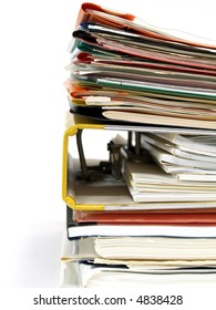 An unorganized stack of documents