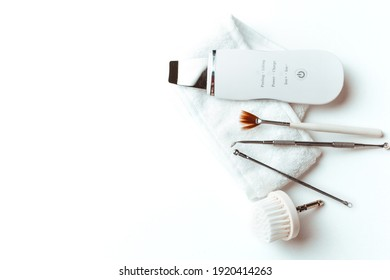 uno's scrubber spoon on a white background top view .the concept of cosmetology and spa .space for text