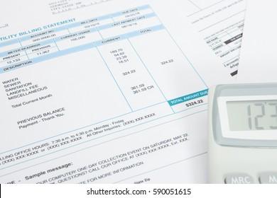 Unpaid utility bill and calculator over it series - close up studio shot