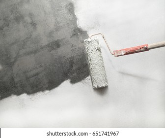 unpainted part concrete with paint roller on move