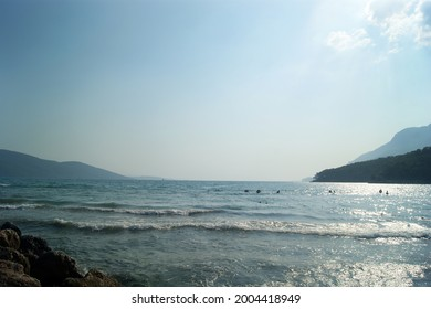 Unparalleled view of calm waves and soft sunlight hitting the shore in the afternoon.