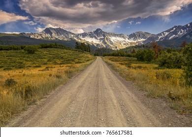 Unpaved Colorado County Road 9 goes towards San Juan Mountain Range Near Telluride Colorado USA