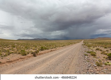 Unpaved road and storm clouds on the horizon