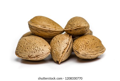 Unpeeled almonds isolated on white background