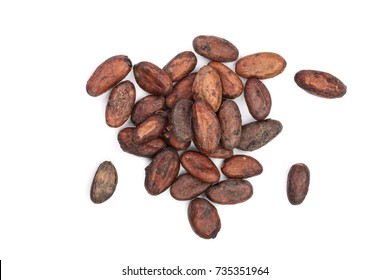 unpeeled cocoa bean isolated on white background close-up top view