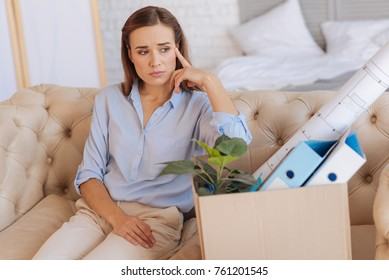 Unpleasant news. Upset serious young woman looking concentrated while thinking how to tell her husband the unpleasant news about her dismission