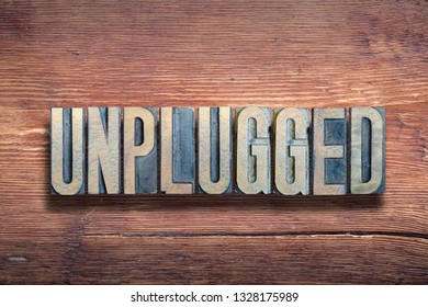 unplugged word combined on vintage varnished wooden surface