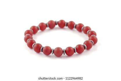 Unpolished carnelian agate beaded bracelet on white background