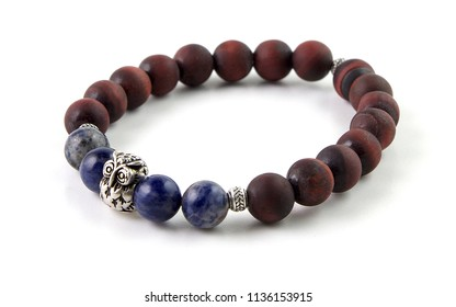 Unpolished red tiger's eye bracelet with blue sodalite stone and silver owl figure at middle